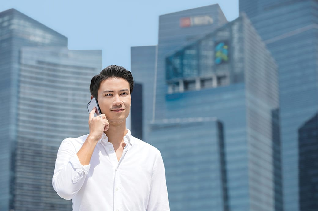 Working adult on handphone, ACUVUE® contact lenses, Singapore