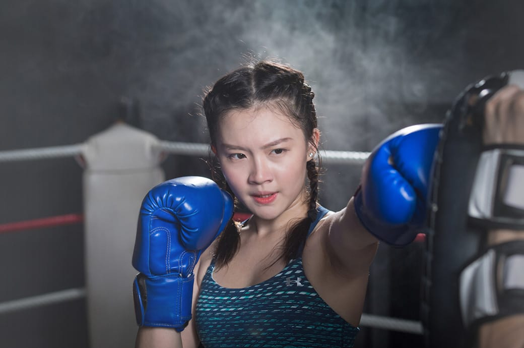 National fencer Joyce Ng doing boxing, wearing ACUVUE® astigmatism contact lenses, Singapore