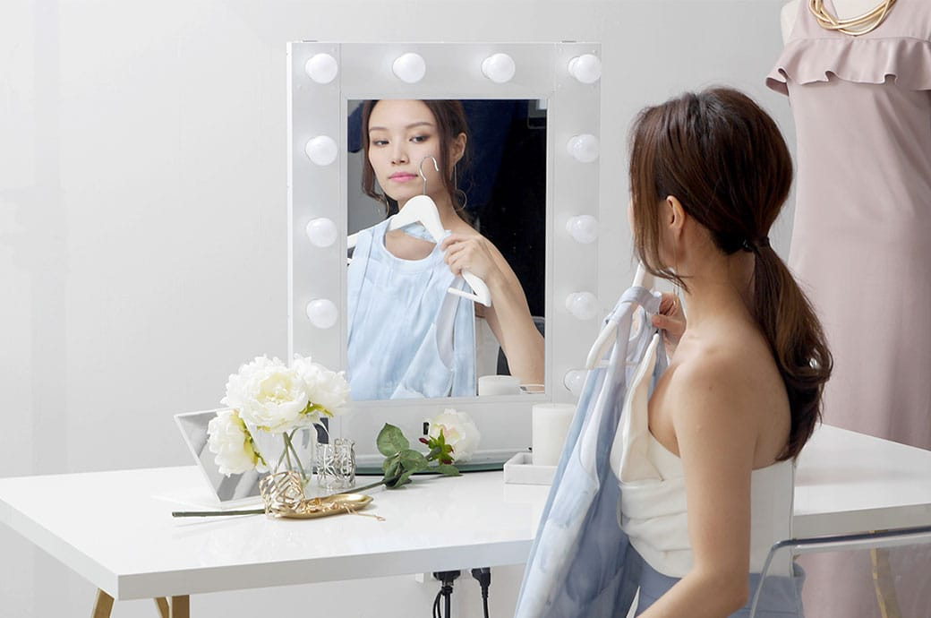 Woman trying on a dress in front of mirror, ACUVUE® DEFINE® contact lenses, Singapore
